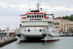The ship catamaran moored in the seaport stock photography
