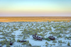 Ship cemetery, Aral Sea, Uzbekistan. Old ships in the desert `ship cemetery` the consequence of Aral sea disaster, Muynak, Uzbekistan Royalty Free Stock Image