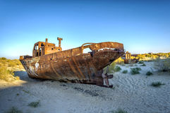 Ship cemetery, Aral Sea, Uzbekistan. Old ships in the desert `ship cemetery` the consequence of Aral sea disaster, Muynak, Uzbekistan Stock Photo