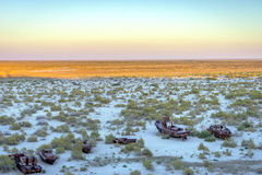 Ship cemetery, Aral Sea, Uzbekistan. Old ships in the desert `ship cemetery` the consequence of Aral sea disaster, Muynak, Uzbekistan Stock Photography