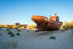 Ship cemetery, Aral Sea, Uzbekistan. Old ships in the desert `ship cemetery` the consequence of Aral sea disaster, Muynak, Uzbekistan Stock Photography