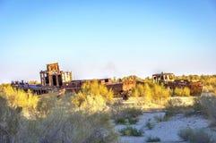 Ship cemetery, Aral Sea, Uzbekistan. Old ships in the desert `ship cemetery` the consequence of Aral sea disaster, Muynak, Uzbekistan stock photos