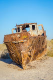 Ship cemetery, Aral Sea, Uzbekistan. Old ships in the desert `ship cemetery` the consequence of Aral sea disaster, Muynak, Uzbekistan Stock Image