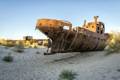Ship cemetery, Aral Sea, Uzbekistan. Old ships in the desert `ship cemetery` the consequence of Aral sea disaster, Muynak, Uzbekistan Royalty Free Stock Photo