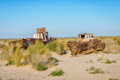 Ship cemetery, Aral Sea, Uzbekistan. Old ships in the desert `ship cemetery` the consequence of Aral sea disaster, Muynak, Uzbekistan Stock Images