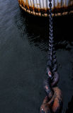 A ship chain attached to a rusting dock. Royalty Free Stock Photography