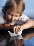 Ship in children hand Royalty Free Stock Photo
