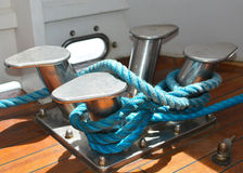 Ship cleat. A rope wrapped around a stainless steel ship cleat Royalty Free Stock Image