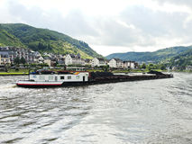 Ship and Cochem town on riverbank of Moselle river Stock Photos