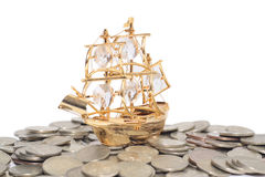 Ship on the coins. Isolated on white Stock Photos