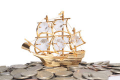 Ship on the coins. Isolated on white Stock Images