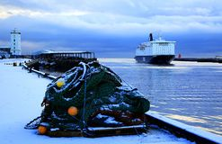 A ship comes in to port in Winter royalty free stock photos