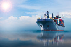 Ship with container on blue sky. Ship with container import export goods to customer for opportunity of business Royalty Free Stock Images