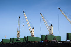 Ship container cranes lift close up for transport story purpose Royalty Free Stock Photography