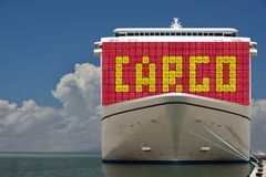 Ship with containers & CARGO text on. royalty free stock photography
