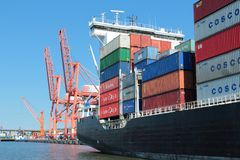 Ship with containers in port Stock Images