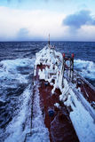 The ship covered with ice. The deck of the vessel covered with ice, in the sea, following in storm conditions Stock Image
