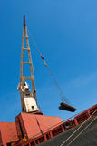 Ship crane with cargo Royalty Free Stock Photos
