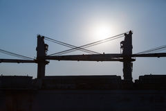 Ship cranes against the sky Stock Photography