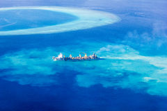 Ship creating new Atoll in the Maldives, North Ari Atolls royalty free stock photography