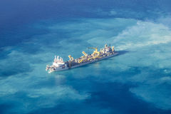 Ship creating new Atoll in the Maldives, North Ari Atolls stock images