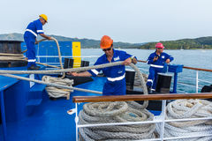 Ship crew working with ropes Stock Photo