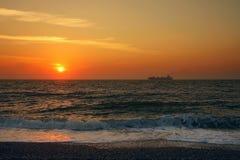 Ship crossing sea at Great Yarmouth sunrise Royalty Free Stock Photos