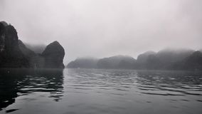 Ship cruise through Halong Bay cliffs in Vietnam - time-lapse stock footage