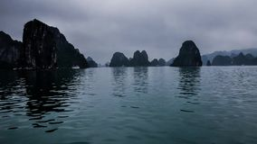Ship cruise through Halong Bay cliffs in Vietnam - time-lapse stock video footage