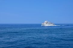 Ship cruising in blue sea. Antipaxos - Ionian Sea - Greece stock images