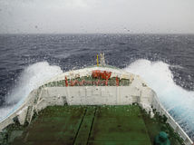 Ship cruising in heavy seas. And rainy wheather Royalty Free Stock Images