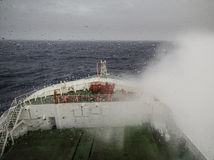 Ship cruising in heavy seas. And rainy wheather Royalty Free Stock Photo