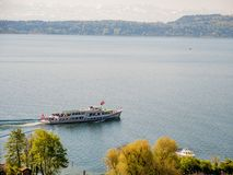 Ship cruising on lake switzerland with mountains stock photography