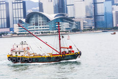 Ship cruising Victoria harbor Royalty Free Stock Photography
