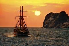 Ship cruisng at sunset Stock Image