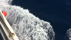 Ship cutting waves, Ionian Sea, Greece, Lefkada island. Lefkada island Greece, Ionian Sea closeup from ship stock video footage