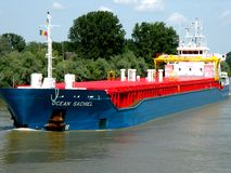 Ship  on the Danube Delta channel. Stock Photo
