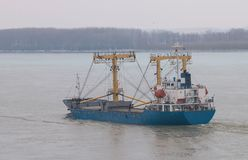 Ship on Danube river,Romania. Ship on Danube river in a cloudy day on territory of Romania Royalty Free Stock Photography