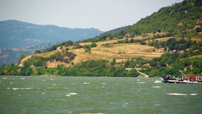 Ship at Danube river with strong winds stock footage