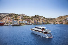 Ship in deam bay on symi on symi island Royalty Free Stock Photo