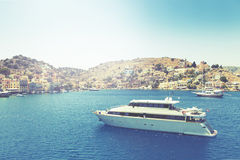 Ship in deam bay on symi on symi island Stock Photos
