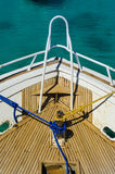 Ship deck with blue rope and yellow rope. On blue see stock photo