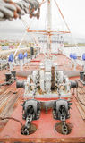Ship deck with engine anchors. View of ship deck with engine anchors and chains Stock Photos