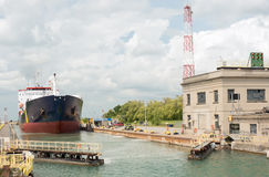 Ship departing canal lock in Welland, Ontario, Canada. A large shipping vessel ready to depart a canal lock where the gates are now opening stock photos