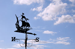 Ship Design Weather Vane. Against a Blue Sky with Cloud Stock Photos