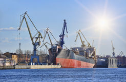 Ship in dock. With elevating cranes royalty free stock photos