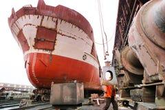 Ship in the dock. Ocean vessel under repair process in dry dock Stock Photography