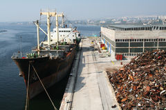 Ship on dock. Cargo industry. Ship on dock lade a metal. Cargo industry of Varna town Bulgaria Stock Image