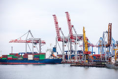 Ship in the dock with elevating cranes Stock Image