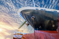Ship in dock. Low angle view nose ship under blue sky and small cloud background in floating dock Royalty Free Stock Image